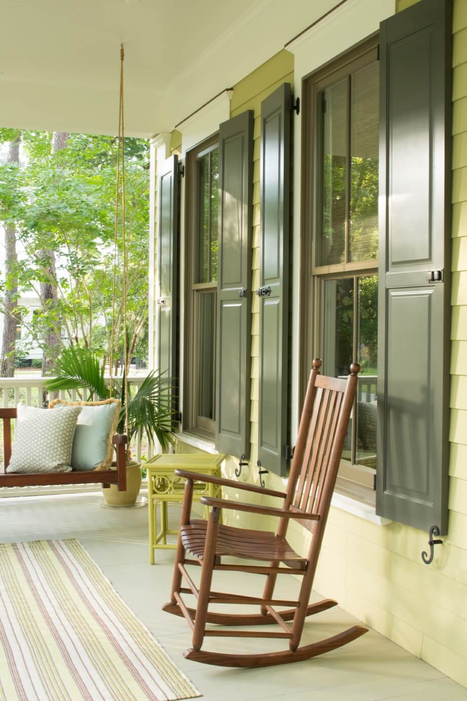 Greenporchdetail With Darkgreenshutters And Rocker